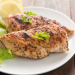 Marinated grilled chicken breasts cooked BBQ and served with fresh herbs and lemon.